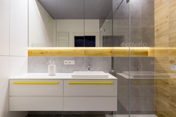 White bathroom with yellow accents - Stock Photo - Images