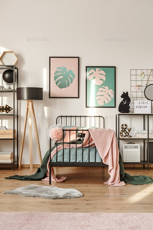Posters above bed - Stock Photo - Images