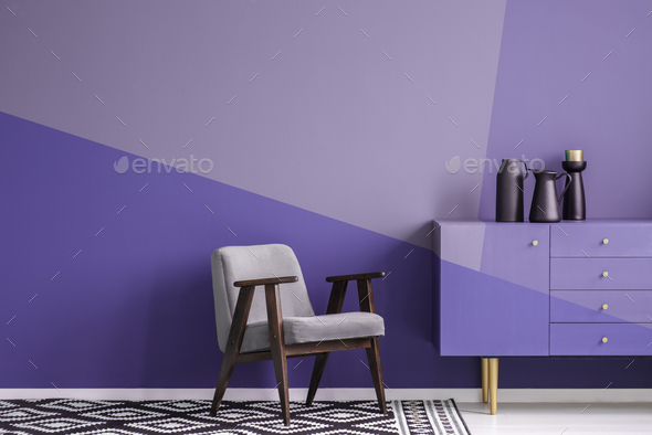 Real photo of a gray, wooden armchair on patterned, black and wh - Stock Photo - Images