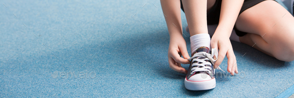 Panorama of child tying shoes - Stock Photo - Images