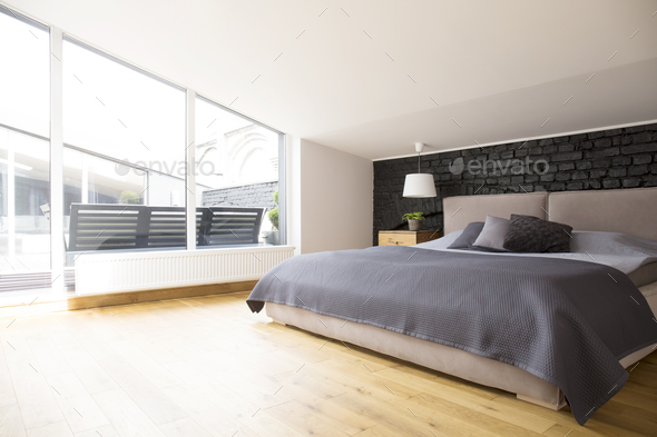 Grey bright bedroom interior - Stock Photo - Images