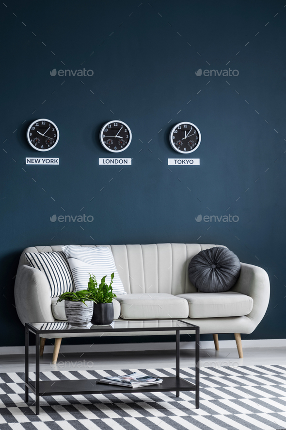 Time zones clocks above sofa - Stock Photo - Images