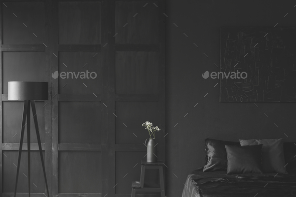 White flowers in black bedroom - Stock Photo - Images
