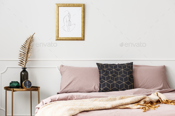 Bed with pink bedding - Stock Photo - Images