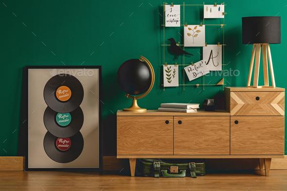 Green bag under retro dresser - Stock Photo - Images