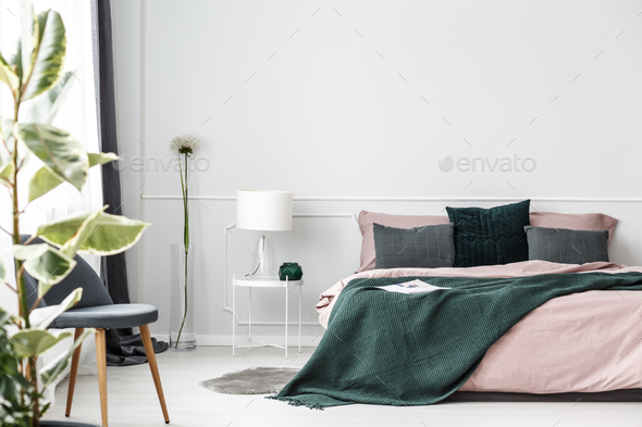 Green blanket on bed - Stock Photo - Images