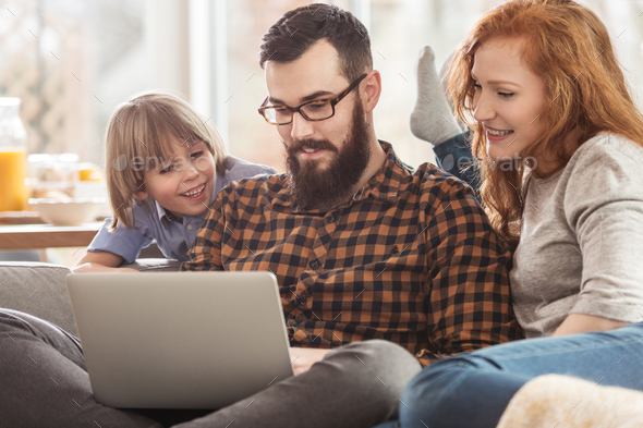 Family watching photos - Stock Photo - Images