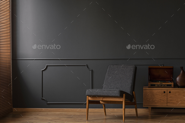 Armchair on empty wall - Stock Photo - Images