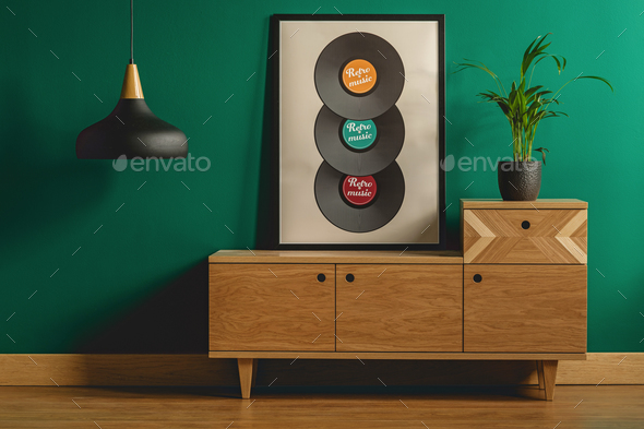 Framed poster on wooden dresser - Stock Photo - Images