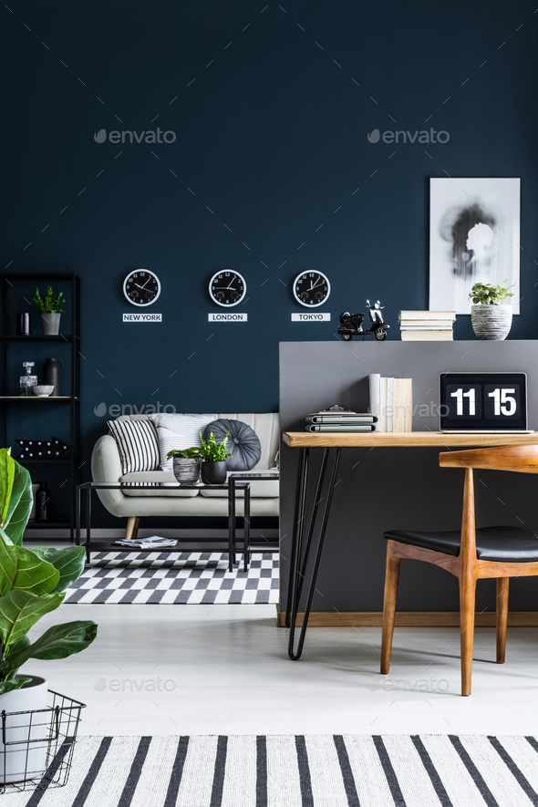 Front view of a home office interior with a desk and chair and l - Stock Photo - Images