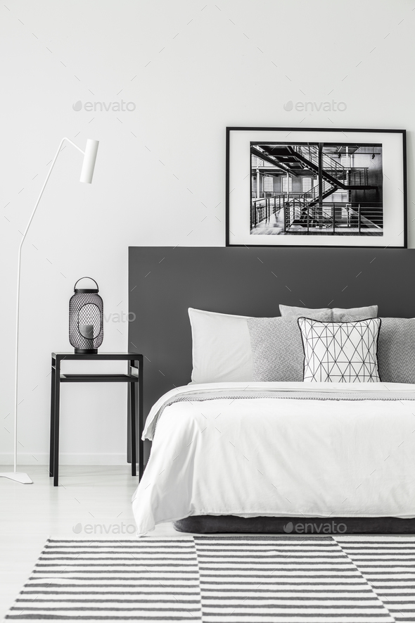 Poster in minimal bedroom interior - Stock Photo - Images