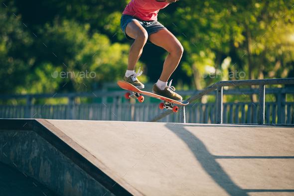Skateboarding at skatepark - Stock Photo - Images
