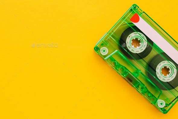 Audio cassette tape on yellow background - Stock Photo - Images
