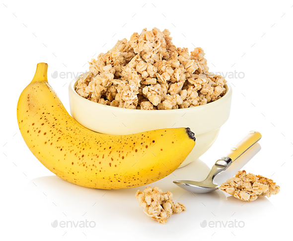 Breakfast cereal with banana close-up isolated on white background. Fitness concept. - Stock Photo - Images