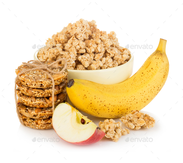 Breakfast cereal with banana and apple close-up isolated on white background. Healthy food. - Stock Photo - Images