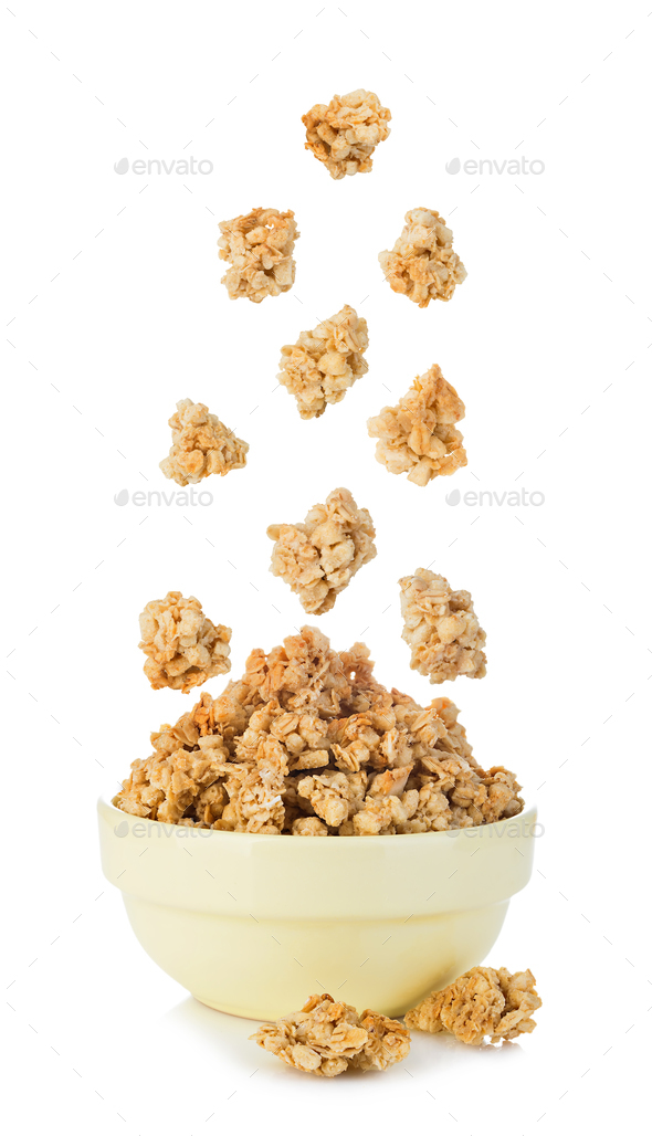 Falling cereal crisps close-up isolated on white background. - Stock Photo - Images