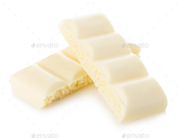 White chocolate pieces close-up isolated on a white background. - Stock Photo - Images