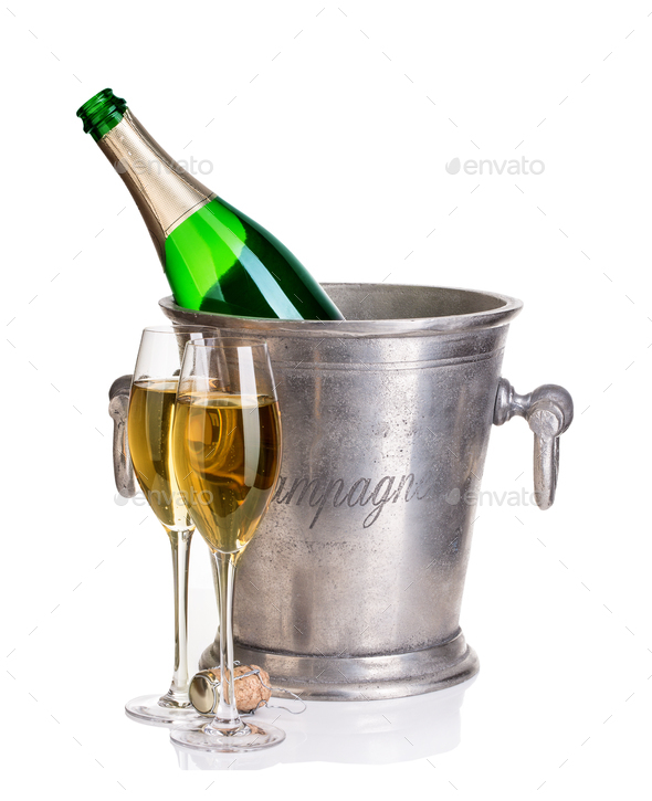 Champagne bottle in ice bucket with glasses of champagne. - Stock Photo - Images
