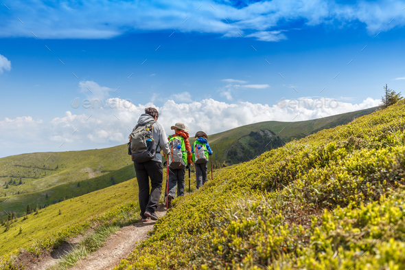 Hiking woman with her children in Romanian mountains - Stock Photo - Images