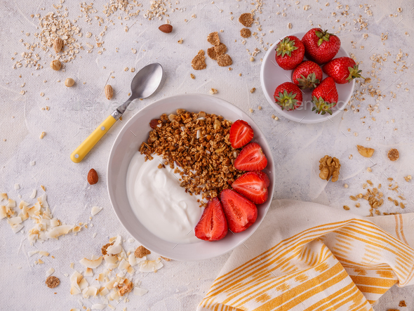 Tasty granola with yogurt - Stock Photo - Images