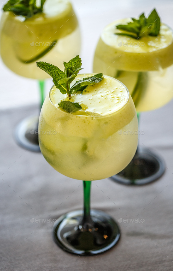 Cocktails with lime, elderflower syrup and ice - Stock Photo - Images