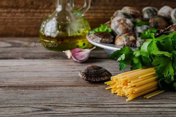 Ingredients with seafood clams for Spaghetti alle Vongole pasta. - Stock Photo - Images