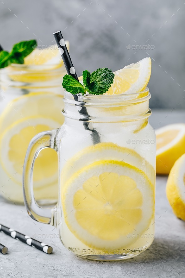 Homemade refreshing summer lemonade drink with lemon slices and ice in mason jars - Stock Photo - Images