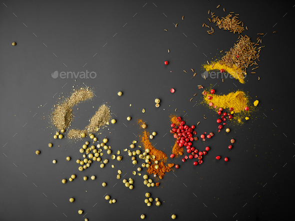 various spices on black background - Stock Photo - Images