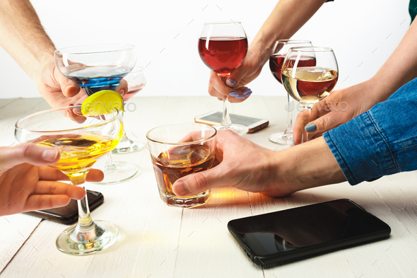 The male and female hands with exotic cocktails - Stock Photo - Images