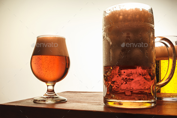 The two mugs of beer on table background - Stock Photo - Images