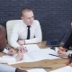 Team of Business People Discussing a Project in a Modern Office - VideoHive Item for Sale