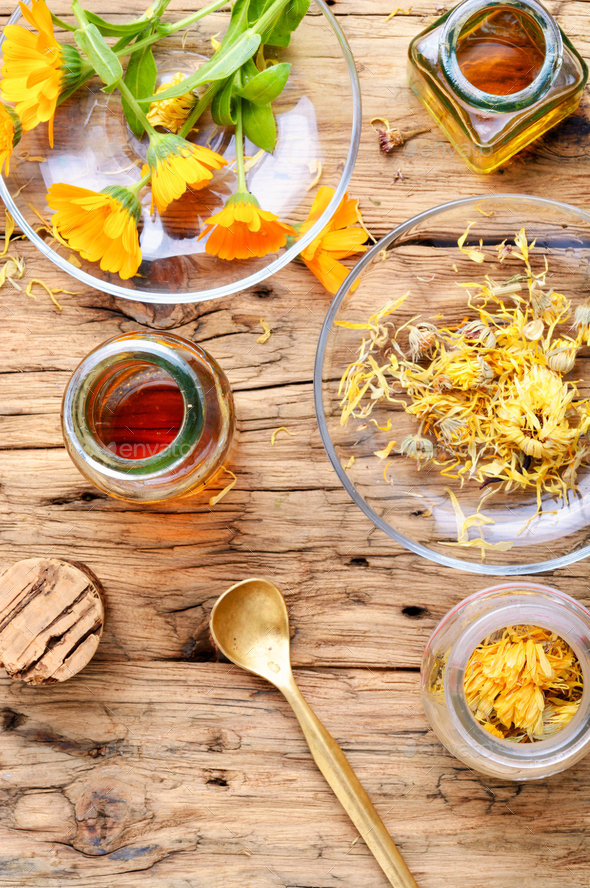 Fresh and dried calendula flowers - Stock Photo - Images