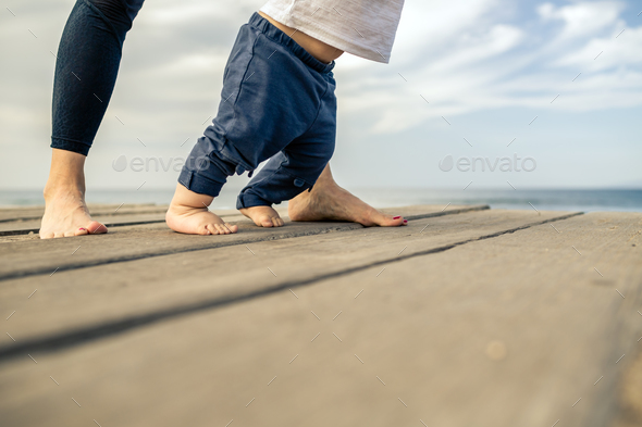 Baby boy walking on the beach in beautiful summer day - Stock Photo - Images