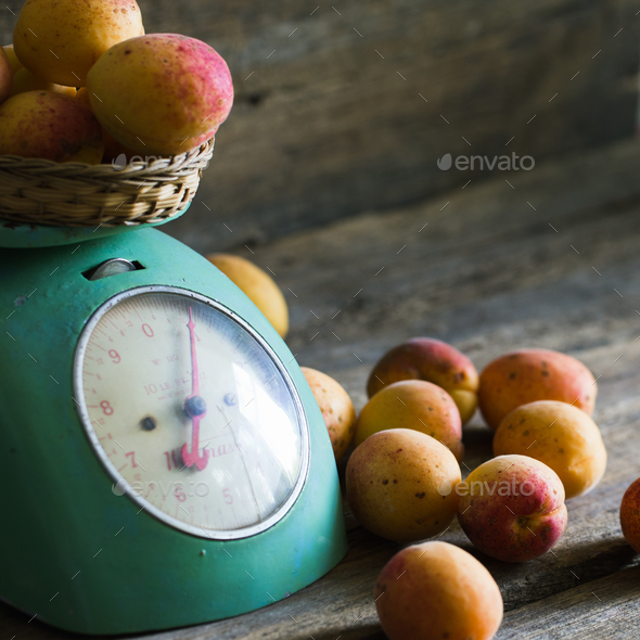 Apricots with kitchen scales on a wood background. toning. Vegetarian food. Healthy life. - Stock Photo - Images