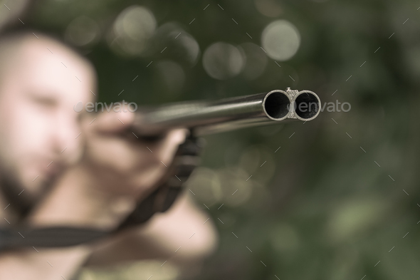 Man aiming a rifle - Stock Photo - Images