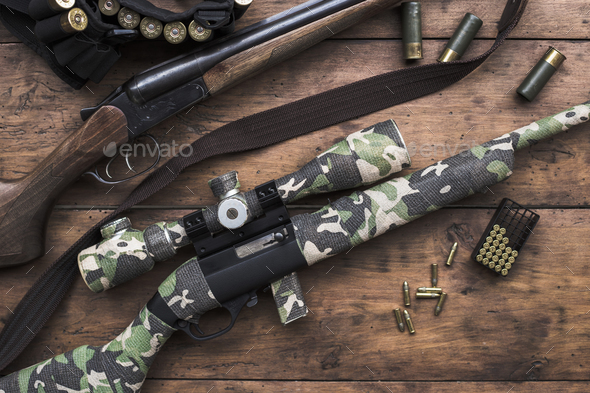 Small caliber 22 long rifle and double-barreled hunting rifle - Stock Photo - Images