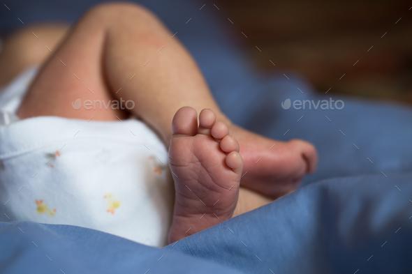 Little fingers. Legs newborn baby - Stock Photo - Images