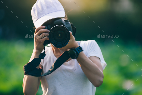 Photographer taking photo - Stock Photo - Images