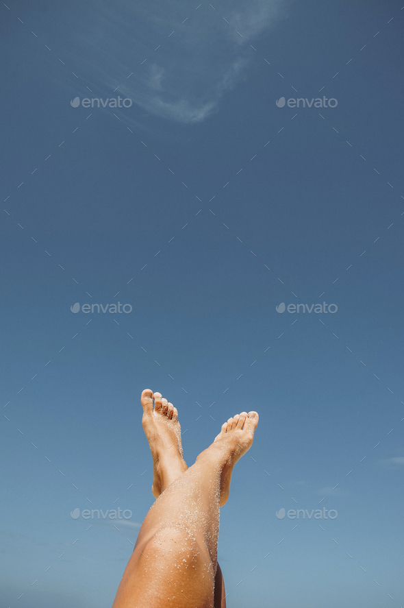 female feet in white sand - Stock Photo - Images