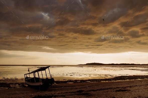 boat on ocean coast during low tide - Stock Photo - Images