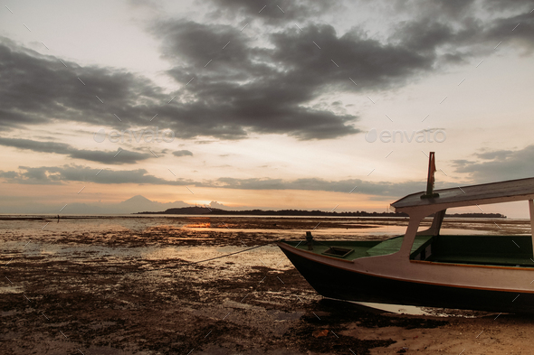 pleasure boat on low tide coastline - Stock Photo - Images