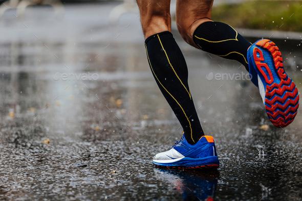 foot men runner in compression socks - Stock Photo - Images