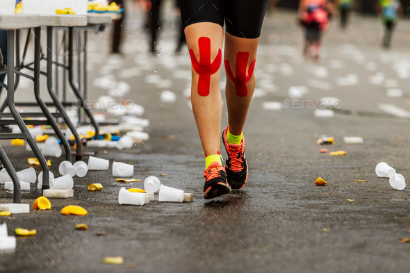 legs female runner red kinesio tape - Stock Photo - Images