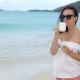 Young Woman with Cup of Hot Coffee Enjoy Holidays - VideoHive Item for Sale