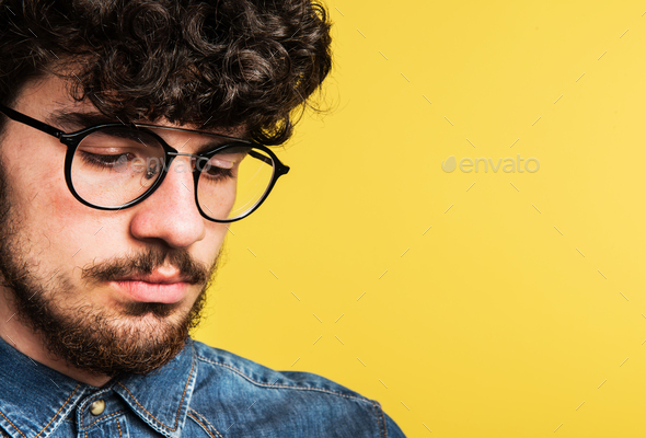 Portrait of a young man in a studio. Copy space. - Stock Photo - Images