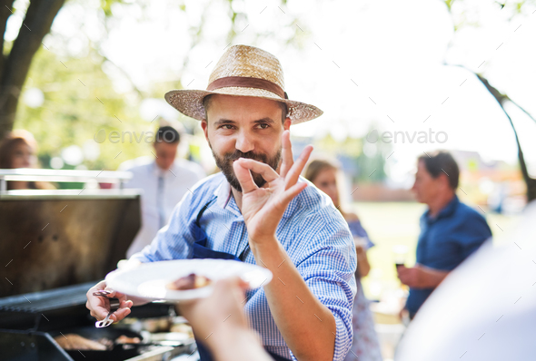 Family celebration or a barbecue party outside in the backyard. - Stock Photo - Images