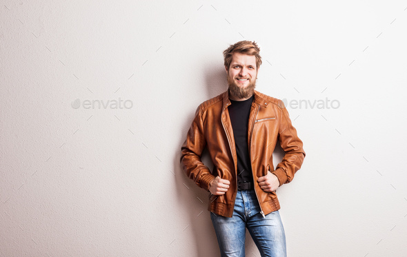 Portrait of a young hipster man in a studio. Copy space. - Stock Photo - Images