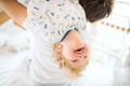 Father holding a happy toddler boy upside down. - PhotoDune Item for Sale