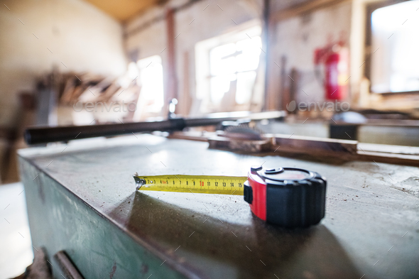 A flexible ruler in a carpentry workshop. - Stock Photo - Images