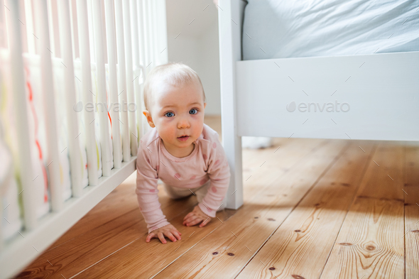 A toddler child crawling on the floor at home. - Stock Photo - Images